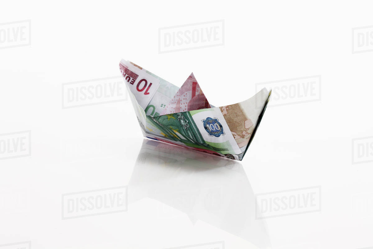 Origami Paper Boat Origami Paper Boat Of Euro Notes On White Background Stock Photo